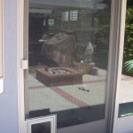 Pet Door installed on sliding screen door