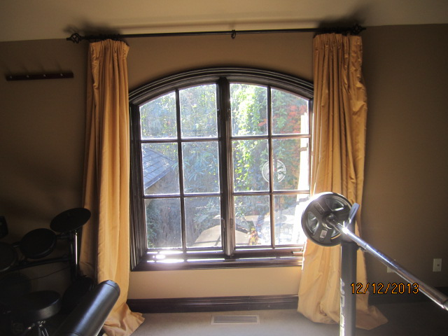 Arched Screens For Double Set French Windows in Brentwood