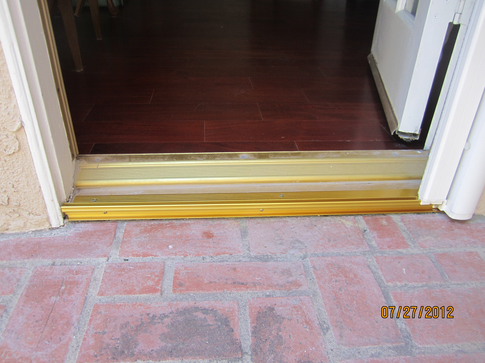 Single swinging door threshold after installation in northridge retractable screen doors for How to install a threshold for an exterior door