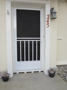 Craftman style swinging screen door .